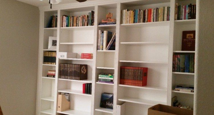 Completed bookcase wall with books.