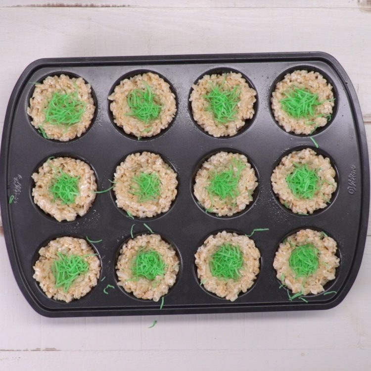 Rice Krispie Nests in muffin tin with coconut grass