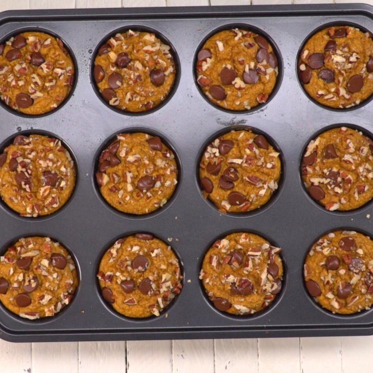 Muffin tin of baked flourless healthy pumpkin muffins
