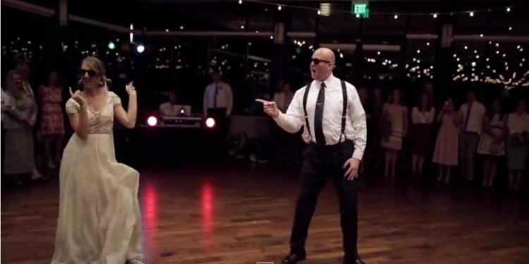 father and daughter dance with sunglasses on at wedding