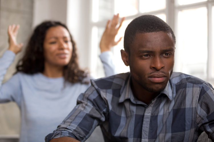 Image of upset african husband feels disappointed in love ignoring angry