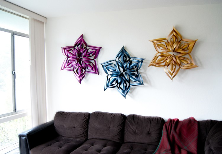 Finished snowflakes hanging over couch.