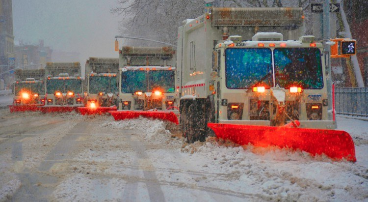 Plows try to clear roadways.