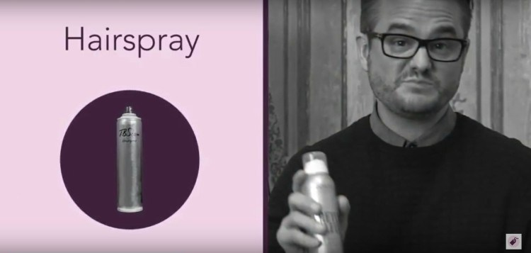 Image of hairspray can and man.