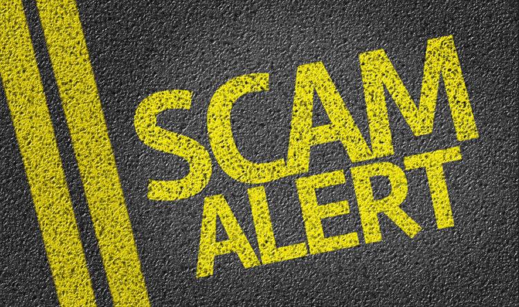 Image of scam alert sign