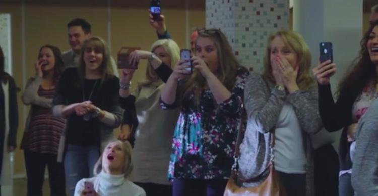 Image of surprised guests at gender reveal
