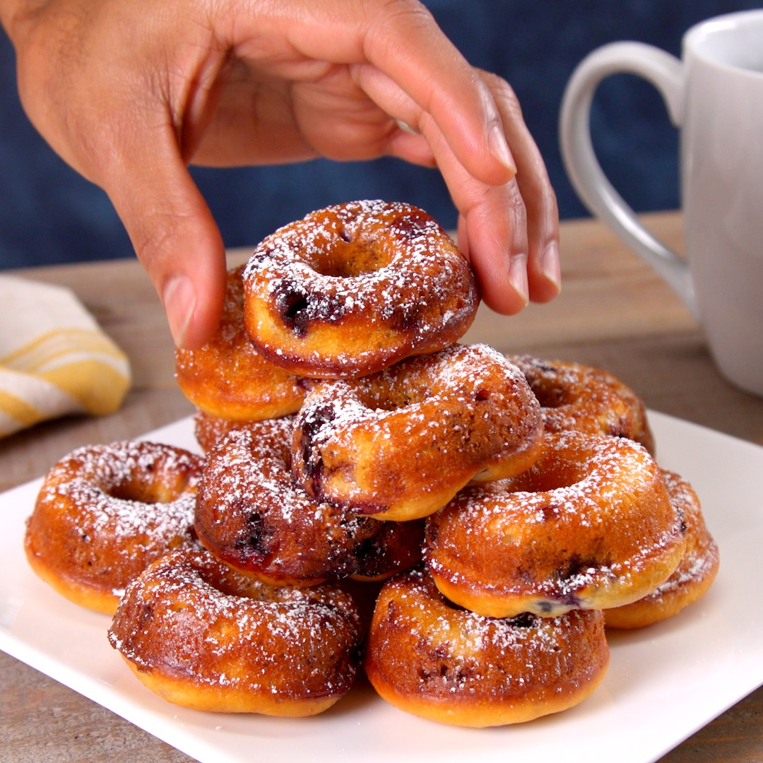 You don't have to wait for a cheat day to eat these yummy oven-baked mini donuts made with Greek yogurt and fresh blueberries.