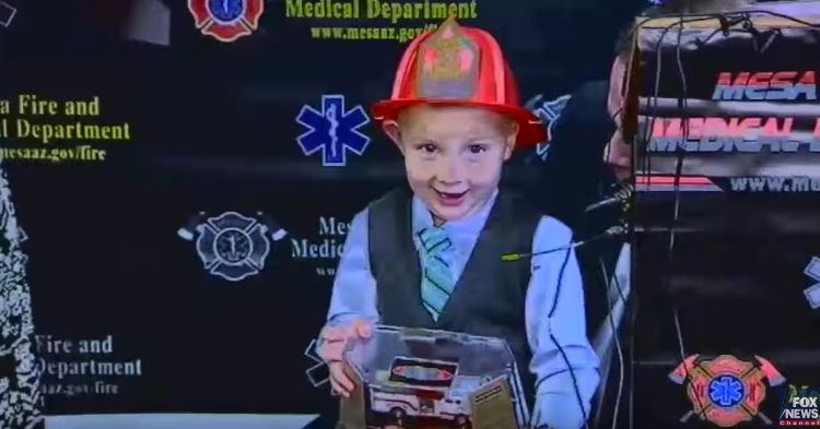 Guy was honored at the fire station for his heroic act.