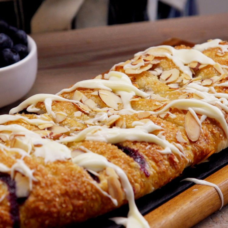 Blueberry Breakfast Braid entire close-up icing almonds