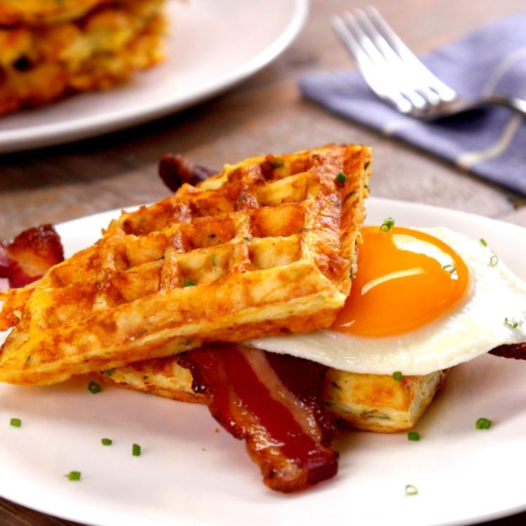 What do you get when you grill eggs, cheddar cheese, and hash browns on a waffle iron? Outrageous savory waffles that make syrup totally irrelevant.