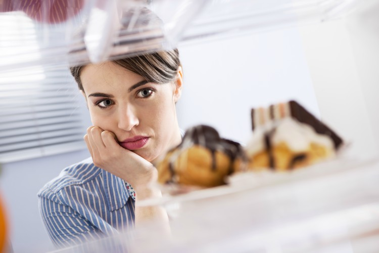 Image of woman craving sweets