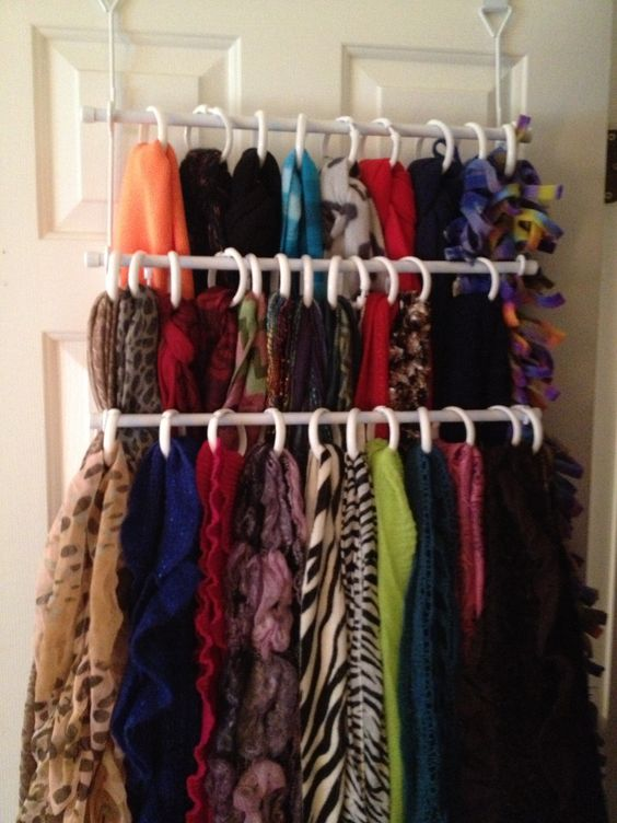 Organizing scarves with towel bars.