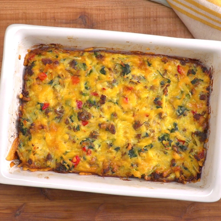 Savory breakfast casserole with sausage, eggs, hash browns, spinach, peppers, & cheese that's so easy, you can make it before you've had your morning coffee.