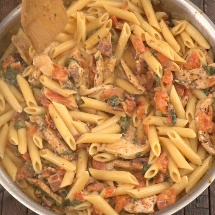 Cooking penne pasta with chicken and bacon