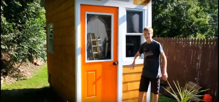 Image of child with tiny house.