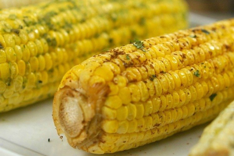 Close-up of corn on the cob cooked 3 ways in the slow cooker
