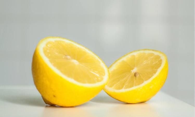 lemon halves on white background
