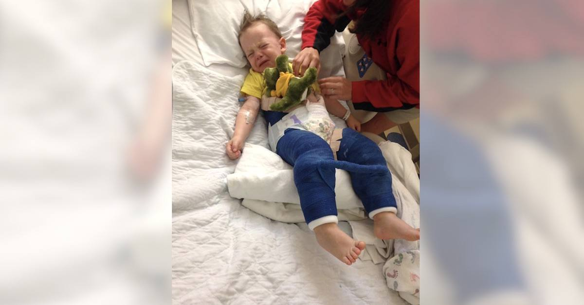 Toddler crying with broken leg.