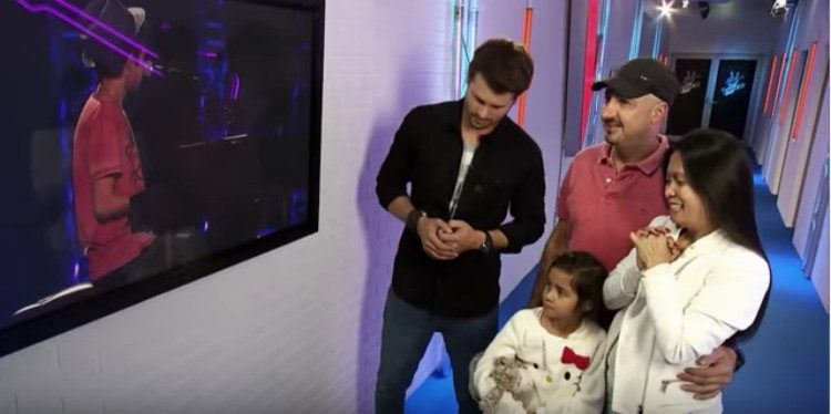 Lukas Janisch's family and host watching monitor