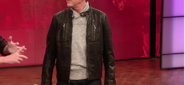 man poses in a leather jacket