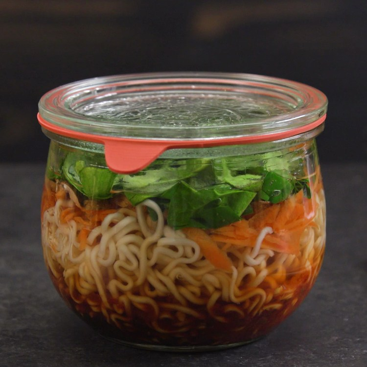 This meal prep idea will save you from lunch fatigue: healthy ramen noodle jars packed with fresh veggies, homemade Asian-style broth, and a hard-boiled egg.