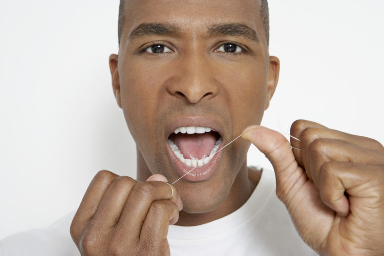 Image of man flossing.