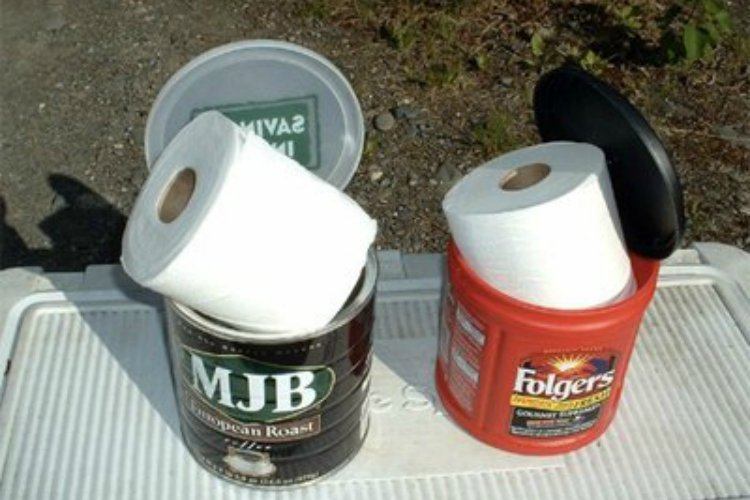 Use an empty coffee can to keep toilet paper dry while camping