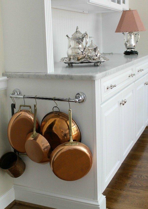 Towel bar to organize pots and pans.
