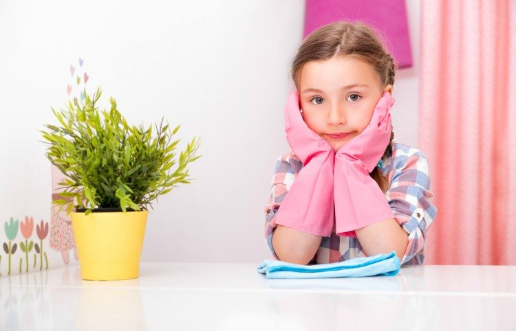Image of young girl with cleaning gloves on.