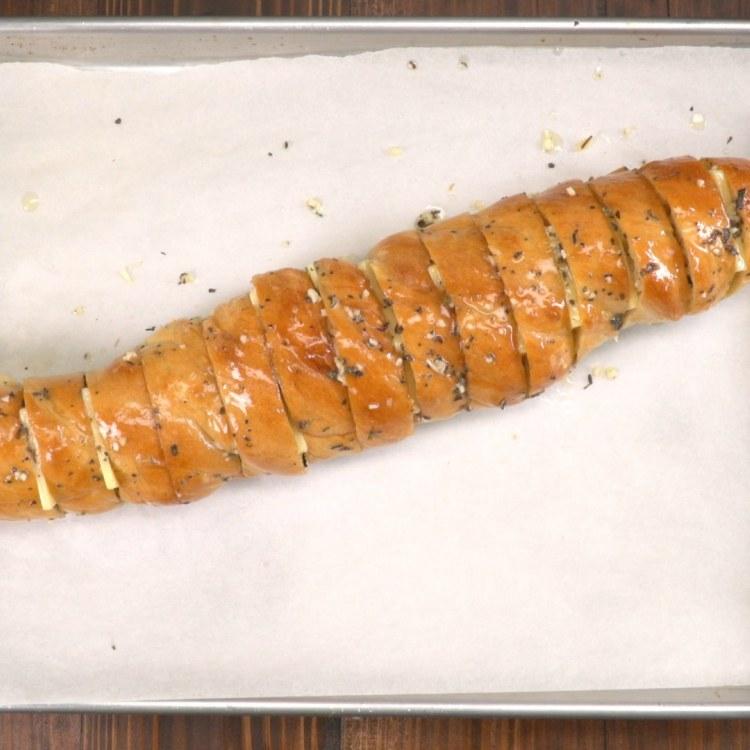 Stuffed hasselback garlic cheesy bread before second bake