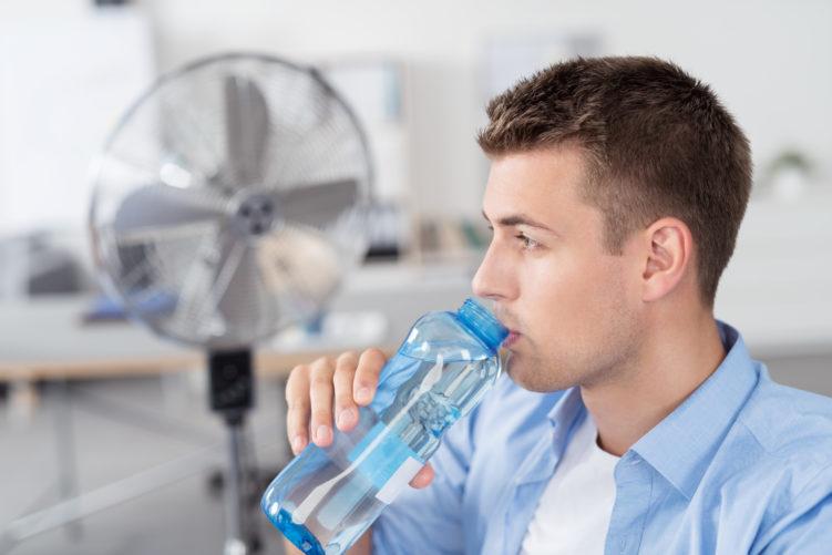 Image of man drinking water