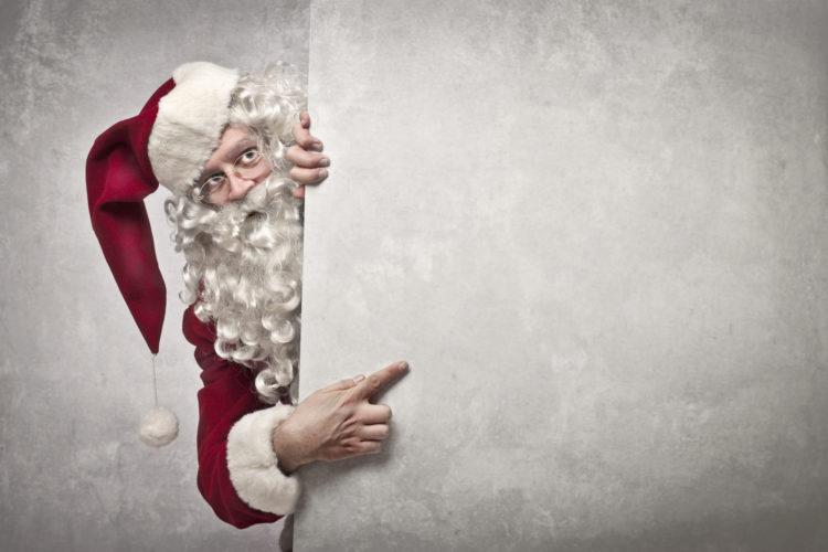 Image of Santa claus peeking behind a wall