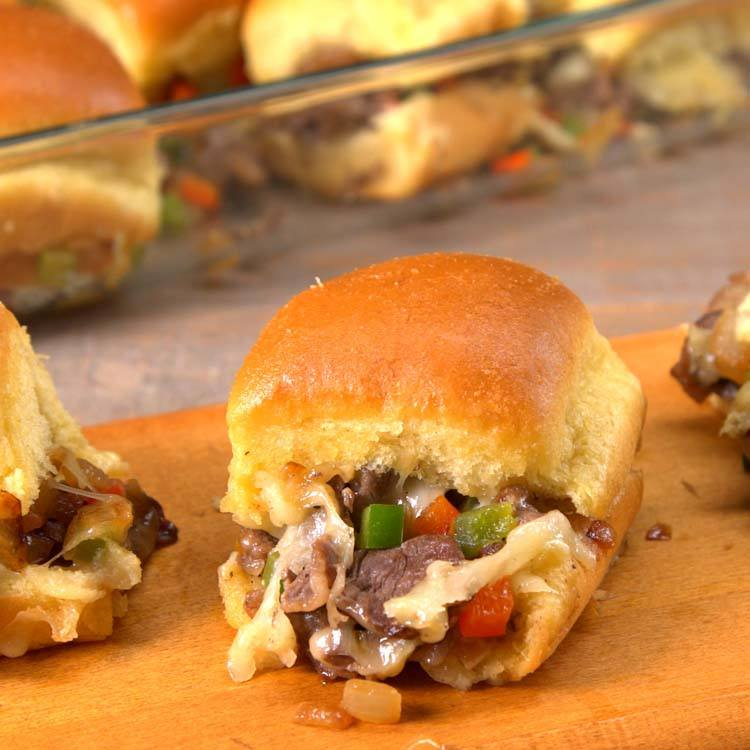 Philly Cheesesteak Sliders close-up with cheese, onions, peppers, and steak