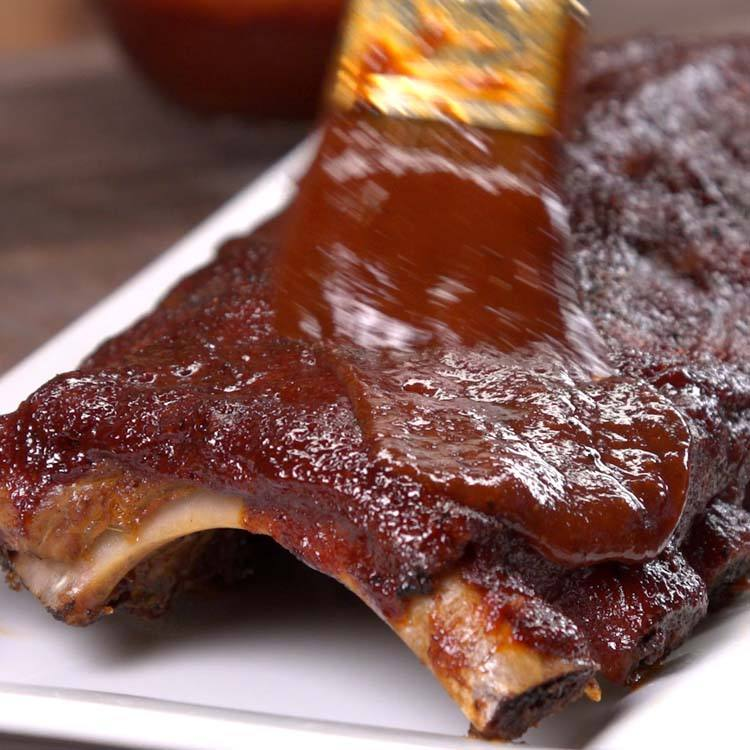 Baked BBQ Ribs saucing