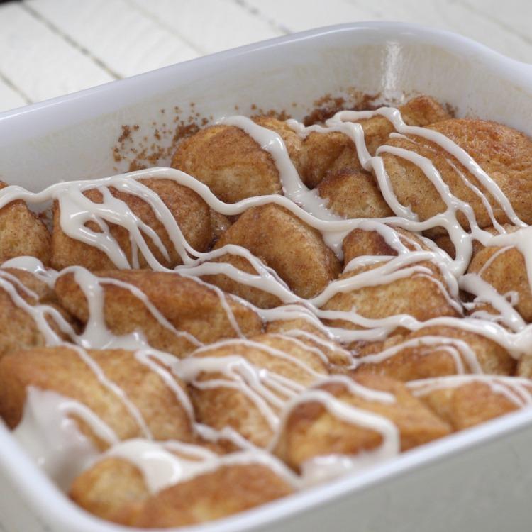 White pan of baked cinnamon roll bites
