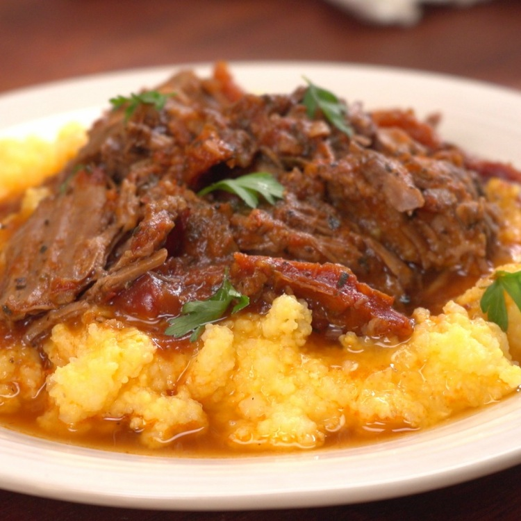 Pot roast made Italian-style in slow cooker on bed of mashed potatoes