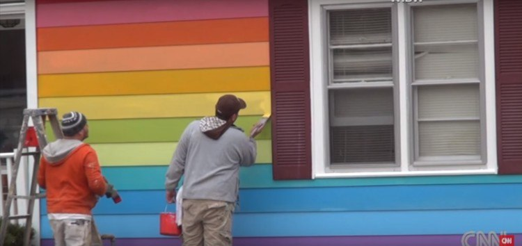Crew paints the Equality House.