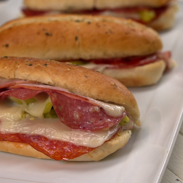 Baked sandwiches with Italian meats and garlic herb butter
