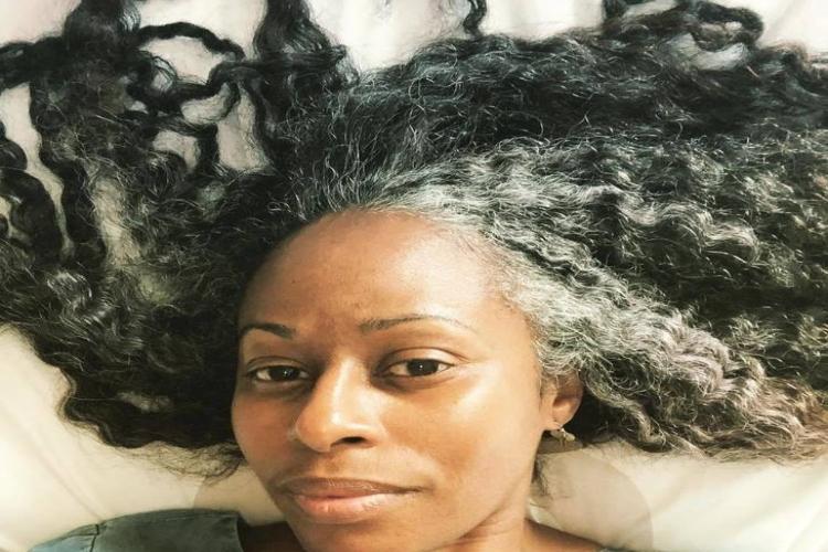 Woman with grey hair spread.