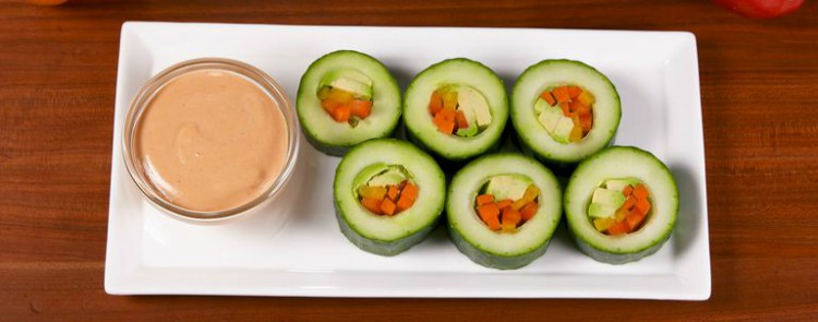 Image of cucumber sushi on a plate with suace