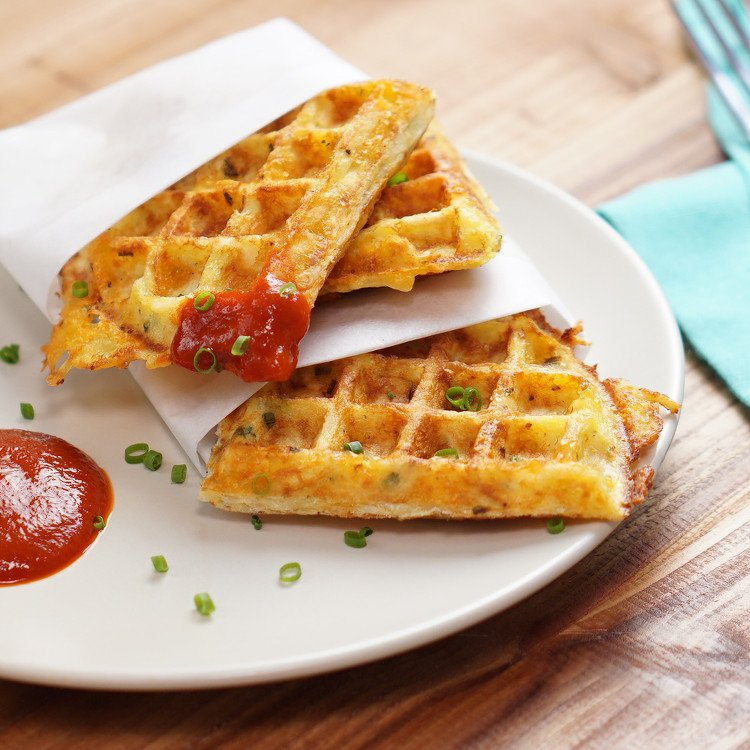 What do you get when you grill eggs, cheddar cheese, chives, and hash browns on a waffle iron? Outrageous savory waffles that make syrup totally irrelevant.