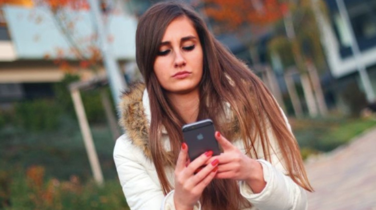 girl looking at a cell phone