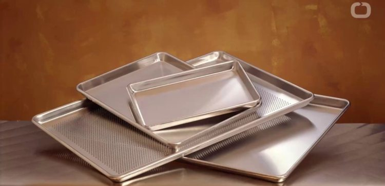 Image of cleaning baking pans.