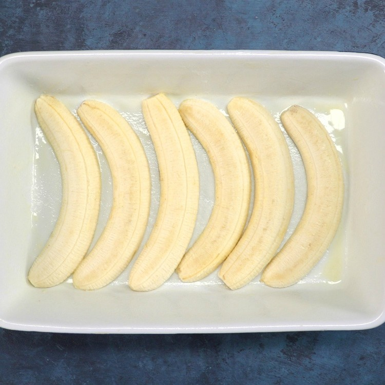 Arrange the bananas, cut side down, in the prepared pan a