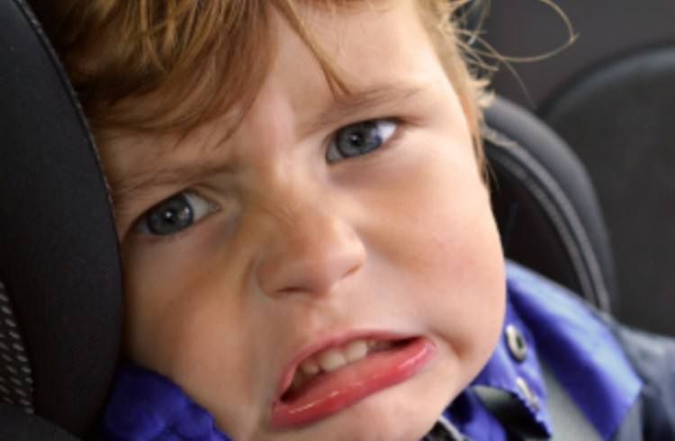 Image of unhappy child.