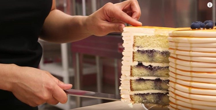 A slice into the pancakes cake.