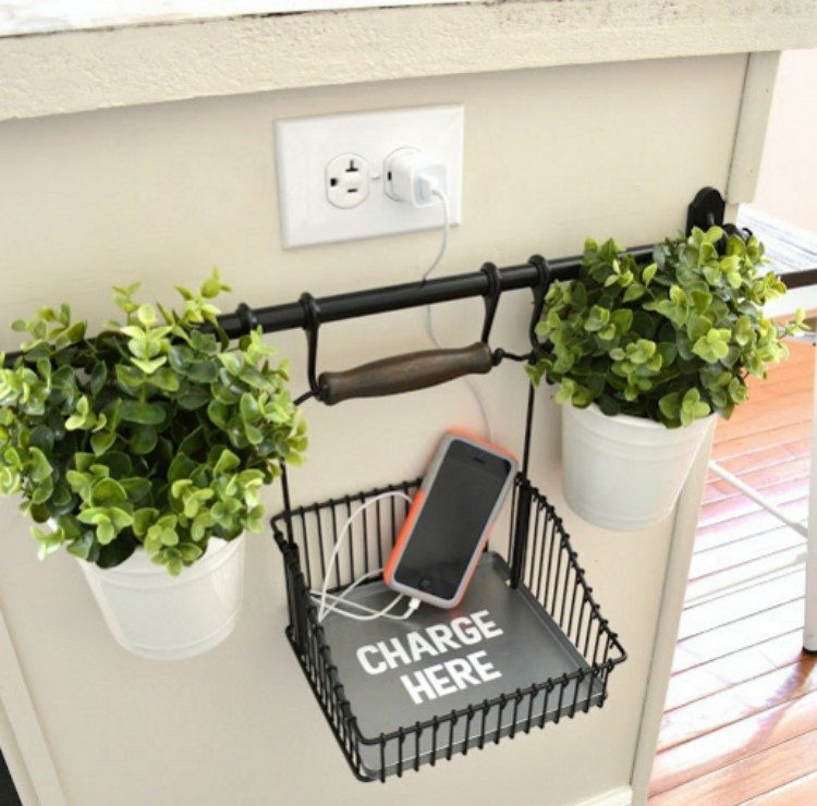 Phone charging station with towel bar.