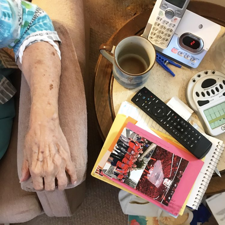 Image of elderly woman with post card