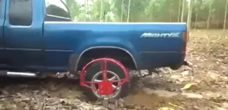 The iron wheel over the regular tire.