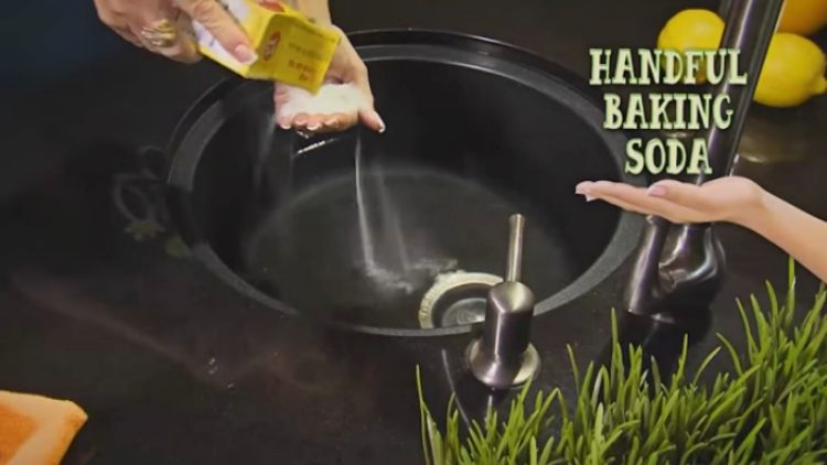 Add a handful of baking soda to the filled sink